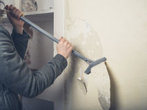 Woman in coast stripping wallpaper Stock Photo