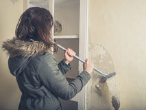 Woman in coast stripping wallpaper Stock Image