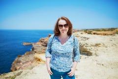 Woman at coastline in Algarve region Royalty Free Stock Photo
