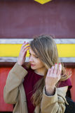 Woman in coat adjust hairs Royalty Free Stock Photo