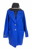 Woman coat. Woman blue vintage coat with black hat Royalty Free Stock Images