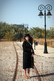 Woman in coat bundled up standing on the rails Stock Photography