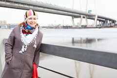 Woman in coat and hat on city embankment Royalty Free Stock Photos