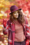 Woman in coat with hat and scarf in autumn park Stock Photography