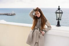 Woman in coat, outdoor. Beautiful girl in spring day outdoors. Girl with long hair stock photos