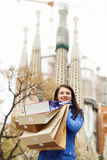 Woman in  coat with purchases against Sagrada familia Royalty Free Stock Photo