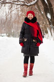 Woman in coat and red cap Stock Images
