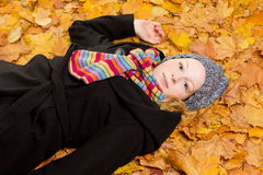 Woman coat scarf maple leaves Royalty Free Stock Images