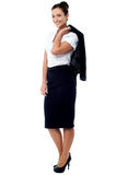 Woman with coat slung over her shoulder Royalty Free Stock Images
