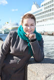 Woman in coat standing on city embankment Royalty Free Stock Photos