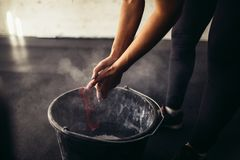 Woman coating her hands in powder chalk magnesium Stock Photography