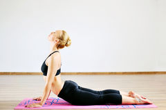 Woman in the cobra yoga pose.  Stock Image