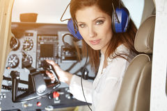 Woman in cockpit. Beautiful woman in airplane cockpit Royalty Free Stock Image