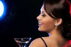 Woman with cocktail. Beautiful woman in evening dress with cocktail having fun Royalty Free Stock Photos