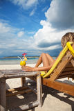 Woman with a cocktail on beach Royalty Free Stock Photography