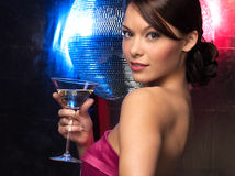 Woman with cocktail and disco ball Stock Photography