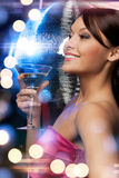 Woman with cocktail and disco ball Royalty Free Stock Photos