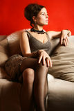 Woman in cocktail dress in interior Stock Photo
