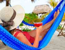 Woman with cocktail relaxed on tropical beach Stock Image