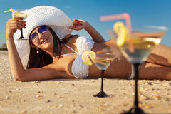 Woman with cocktail relaxing on beach Royalty Free Stock Photography