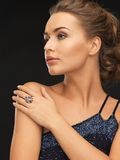 Woman with cocktail ring. Beautiful woman in evening dress with cocktail ring Royalty Free Stock Image