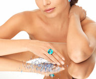 Woman with cocktail ring and stones Stock Photography
