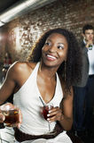 Woman With Cocktail Sitting In Bar Royalty Free Stock Photography