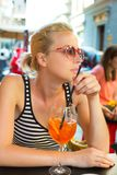Woman with cocktail in street cafe. Stock Photos