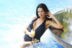 Woman with cocktail in swimming pool Stock Photography