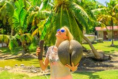 Woman with coco de mer stock photography
