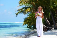 Woman with a coconut cocktail Stock Images