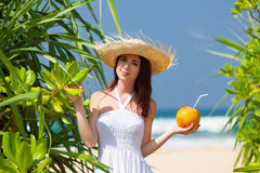 Woman with coconut cocktail Royalty Free Stock Photos