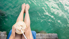 Woman with coconut on tropical destination Stock Images