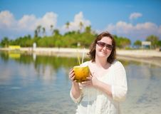 Woman with coconut on a tropical resort Royalty Free Stock Images