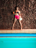 Woman with coctail and balloons on pool. Stock Images