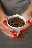 Woman and a cofee mug. Royalty Free Stock Images
