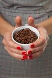 Woman and a cofee mug. Royalty Free Stock Photography