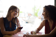 Woman at coffe shop table Stock Photography