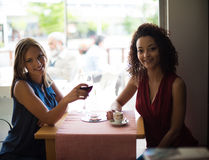 Woman at coffe shop table Royalty Free Stock Photography