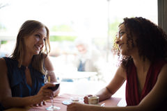 Woman at coffe shop table Stock Image