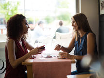 Woman at coffe shop table Royalty Free Stock Images