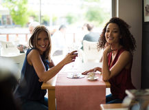 Woman at coffe shop table Stock Photo