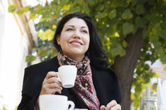 Woman and coffee autumn Stock Images