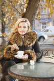 Woman and coffee autumn Royalty Free Stock Photos