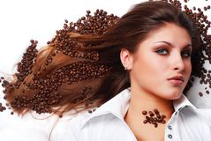 Woman with coffee beans Royalty Free Stock Image