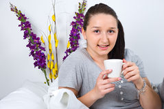 Woman with coffee in bed royalty free stock photos