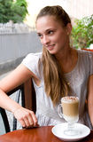 Woman with coffee in cafe Stock Images