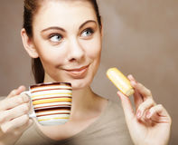 Woman with coffee and cookies Stock Image