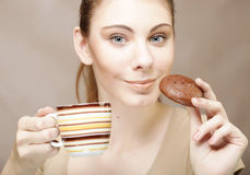 Woman with coffee and cookies Royalty Free Stock Image