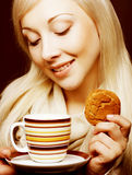Woman with coffee and cookies Stock Photography
